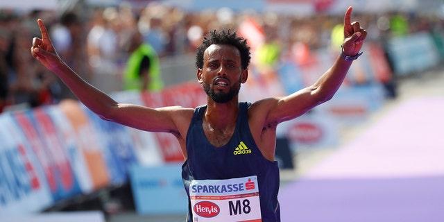 Ethiopia's Derara Hurisa celebrates after thinking he had won the race.