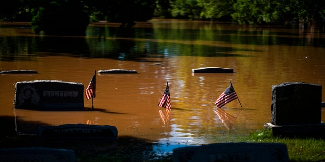 Headstones at a cemetery that flooded are seen in Somerville, N.J. Thursday, Sept. 2, 2021.