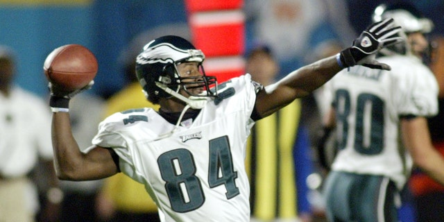 Philadelphia Eagles wide receiver Freddie Mitchell throws a 26-yard running back option for a touchdown against the Miami Dolphins in the second quarter in Miami, Fla. On December 15, 2003.