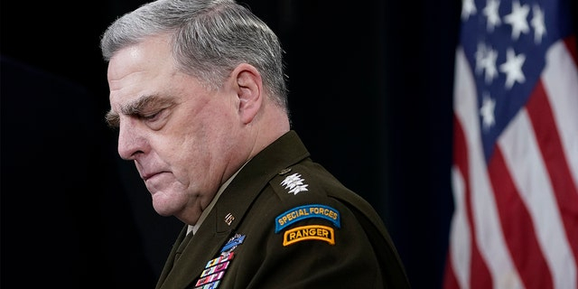 Joint Chiefs of Staff Gen. Mark Milley listens during a briefing with Secretary of Defense Lloyd Austin at the Pentagon in Washington, Wednesday, Sept. 1, 2021, about the end of the war in Afghanistan.