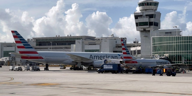 American Airlines planes are seen at the gates at Miami International Airport (MIA) on August 1, 2021 in Miami, Florida. (Photo by DANIEL SLIM/AFP via Getty Images)