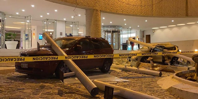 View of damaged cars outside a hotel after a quake in Acapulco, Guerrero state, Mexico on September 7, 2021. (Photo by FRANCISCO ROBLES/AFP via Getty Images)
