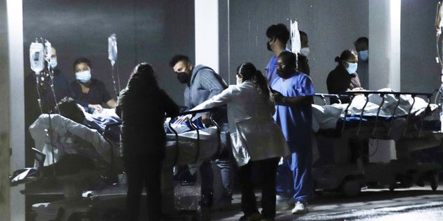 Medical staff move patients out of a hospital after an earthquake in Mexico City, capital of Mexico, on Sept. 7, 2021. (Photo by Sunny Quintero/Xinhua via Getty Images)