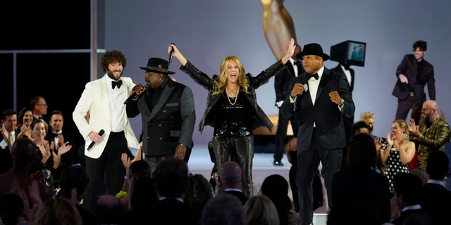 LOS ANGELES - SEPTEMBER 19: Cedric The Entertainer, Rita Wilson, and LL Cool J appear at the 73RD EMMY AWARDS, broadcast Sunday, Sept. 19Cliff Lipson/CBS via Getty Images (8:00-11:00 PM, live ET/5:00-8:00 PM, live PT) on the CBS Television Network and available to stream live and on demand on Paramount+. (Photo by )