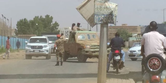 Sudanese soldiers block the road for taking precautions after a failed coup attempt in Qhartoum, Sudan on September 21, 2021. (Photo by Mahmoud Hjaj/Anadolu Agency via Getty Images)