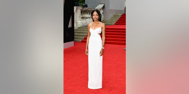 Naomie Harris attends the 'No Time To Die' premiere in customMichael Kors Collection.