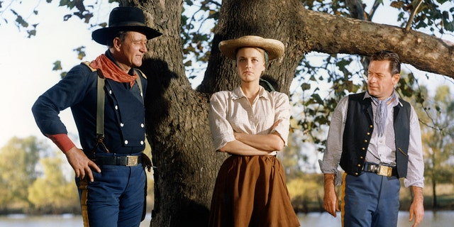 From left: John Wayne, Constance Towers and William Holden