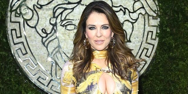 Elizabeth Hurley is seen on the front row of the Versace special event during the Milan Fashion Week - Spring / Summer 2022 on September 26, 2021 in Milan, Italy.