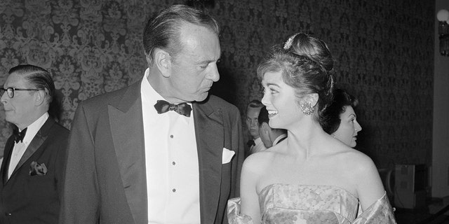 A proud father, Gary Cooper talks with his daughter, Maria, 24, during a party. Cooper was cited by the Friars for his patriotic and philanthropic activities during his three decades as a top movie star.