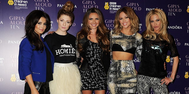 (L to R) Cheryl Cole, Nicola Roberts, Nadine Coyle, Kimberley Walsh and Sarah Harding of Girls Aloud pose at a press conference to announce 'Girls Aloud Ten, The Hits Tour 2013' on October 19, 2012 in London, England