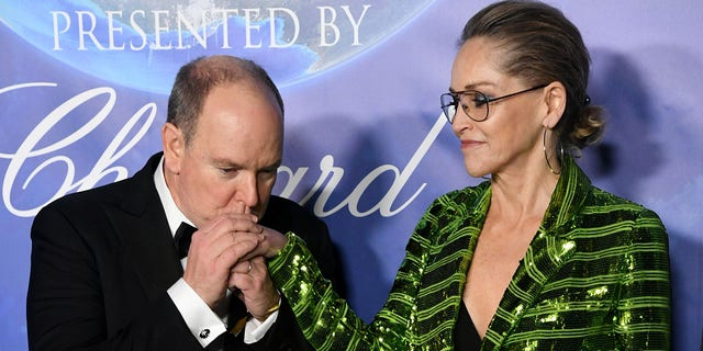 HSH Prince Albert II of Monaco (L) and Sharon Stone arrive at the 2020 Hollywood For The Global Ocean Gala Honoring HSH Prince Albert II Of Monaco at Palazzo di Amore on February 06, 2020 in Beverly Hills, California.