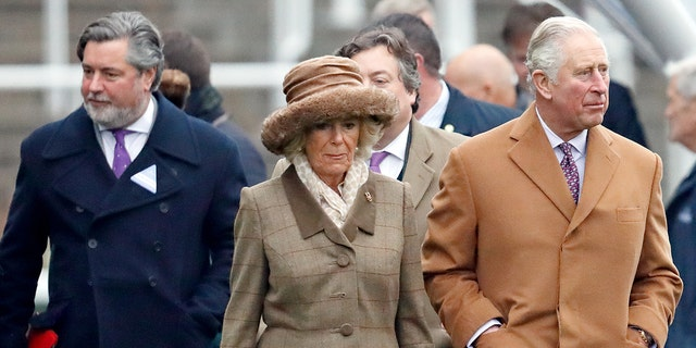 Michael Fawcett (L) accompanies Camilla, Duchess of Cornwall and Prince Charles, Prince of Wales as they attend The Prince's Countryside Fund Race Day at Ascot Racecourse on November 23, 2018 in Ascot, England.