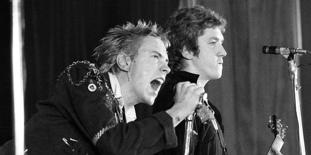 Johnny Rotten (John Lydon, left) and Steve Jones performing live onstage.