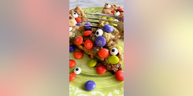 """The """"Goblin Skillet Cookie"""" is a giant chocolate chip cookie with oats, M&M's and candy eyeballs."""