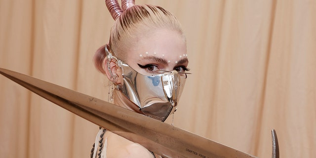 While preparing for the 2021 Met Gala, Grimes told Vogue that she doesn't 'identify with the word mom' and lets her son with Elon Musk call her by her first name, Claire.
