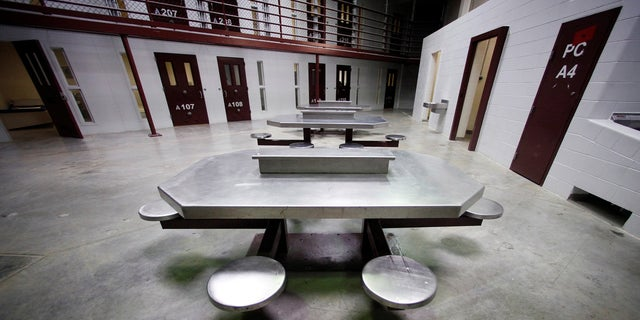 The interior of an unoccupied communal cellblock at Camp VI, a prison used to house detainees at the U.S. Naval Base at Guantanamo Bay, in 2013.