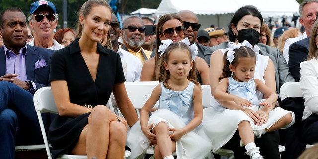 Derek Jeter and Hannah Jeter's two daughters, Story Grey, 1, and Bella Raine, 3, made a rare public appearance at his enshrinement into the National Baseball Hall of Fame.