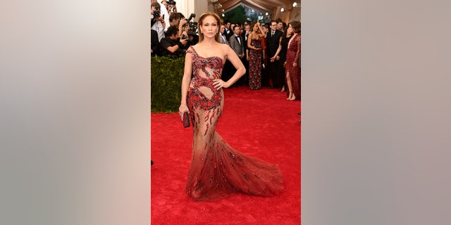 Jennifer Lopez rocked a sheer red dress featuring a dragon at the 2015 con Gala.