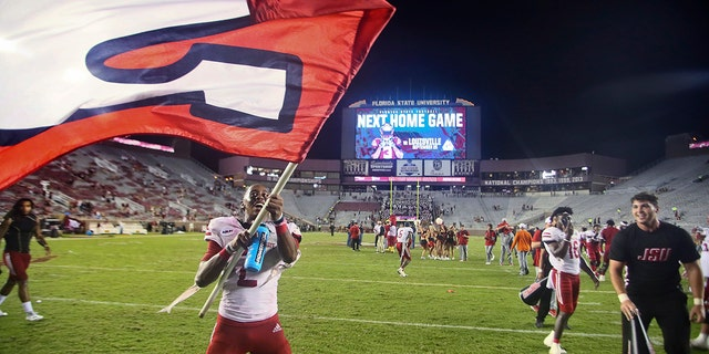 Jacksonville State wide receiver Michael Pettway (2) waves a flag on the field after the team's 20-17 win over Florida State in an NCAA college football game Saturday, Sept.. 11, 2021, in Tallahassee, Fla. (AP Photo/Phil Sears)
