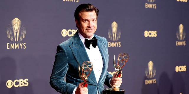 Jason Sudeikis poses with his Emmy awards on the red carpet during the 73rd Annual Emmy Awards taking place at LA Live on Sunday, Sept.. 19, 2021 in Los Angeles, CA.
