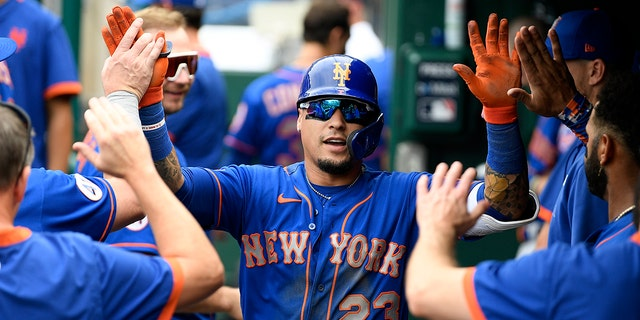New York Mets' Javier Baez celebrates his canoe home run in the third inning of a baseball game against the Washington Nationals on Sunday, September 5, 2021, in Washington.  (AP Photo / Nick Wass)