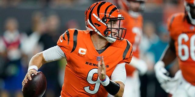 Cincinnati Bengals quarterback Joe Burrow (9) looks to throw during the first half of an NFL football game against the Jacksonville Jaguars, Thursday, Sept. 30, 2021, in Cincinnati.