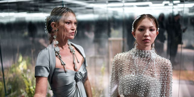 British model Kate Moss and her daughter Lila Grace Moss-Hack present creations by British designer Kim Jones for Fendi's Spring-Summer collection during the Paris Haute Couture Fashion Week in Paris, on January 27, 2021.