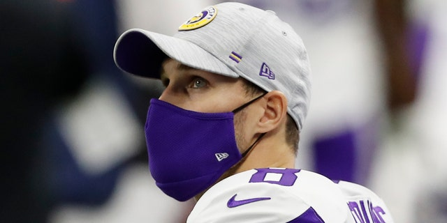 Minnesota Vikings quarterback Kirk Cousins looks up at the big-screen display during the first quarter against the Detroit Lions at Ford Field.
