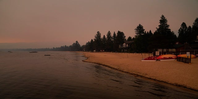 An empty beach is seen on Tuesday, Ago. 31 after a mandatory evacuation was ordered due to the Caldor Fire in South Lake Tahoe, Calif.