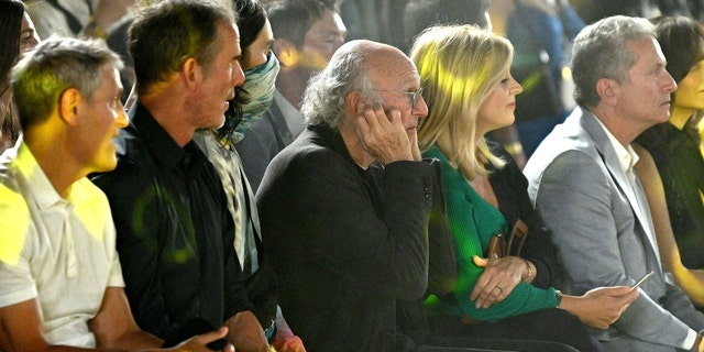 Larry David plugging his ears at a NYFW event.