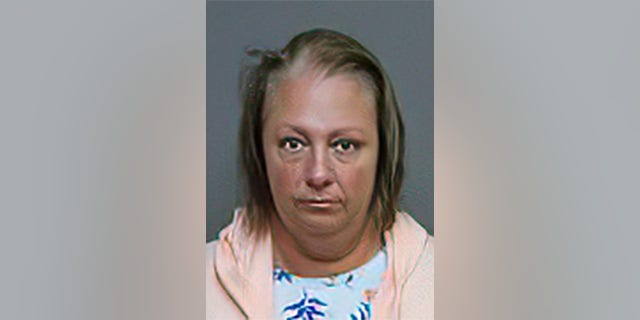 Lori Desjardins, 45, is accused of assaulting and berating a Navy sailor inside a Connecticut pizza shop.