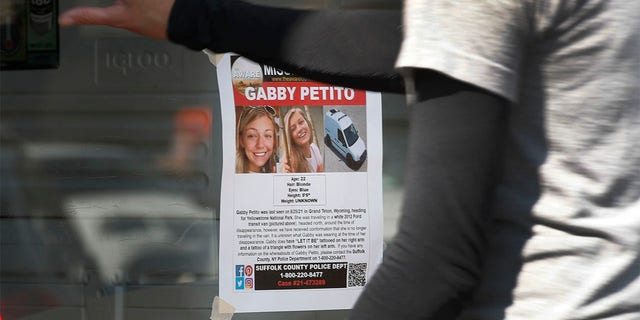 A flyer of Gabby Petito who is missing, hangs on the door of a store as customers enter in Jackson, Wyoming on September 16, 2021. Photo by George Frey