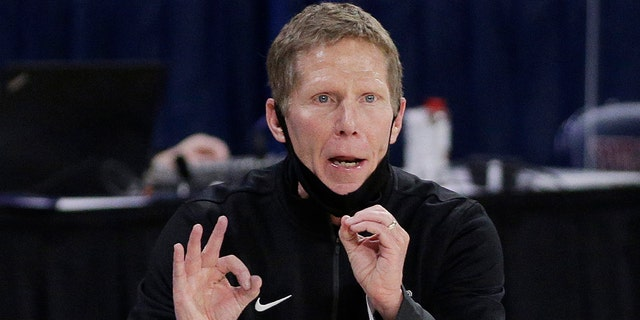 """FILE - In this Feb. 25, 2021, file photo, Gonzaga coach Mark Few signals to players during the second half of an NCAA college basketball game against Santa Clara in Spokane, Wash. Few has been cited for driving under the influence. The Coeur d'Alene Press and Spokesman-Review acquired a police report through a public information request that says Few was stopped Monday evening, Sept. 6, after he was """"called in as driving erratic and speeding."""" (AP Photo/Young Kwak, File)"""