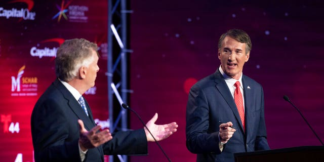 Virginia Democratic gubernatorial candidate and former Gov. Terry McAuliffe, left, and Republican nominee, Glenn Youngkin, participate in their debate at Northern Virginia Community College, in Alexandria, Va., Tuesday, Sept. 28, 2021. (AP Photo/Cliff Owen)