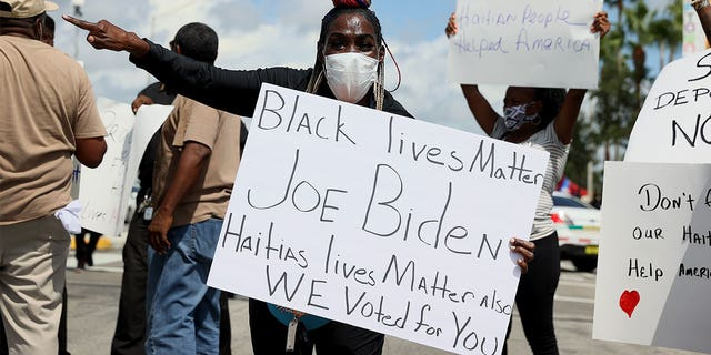 Protesters demonstrate outside a U.S. Citizenship and Immigration Services (USCIS) building in Miami to denounce the expulsion of Haitian refugees from Del Rio, Texas, Sept. 22, 2021. (Getty Images)