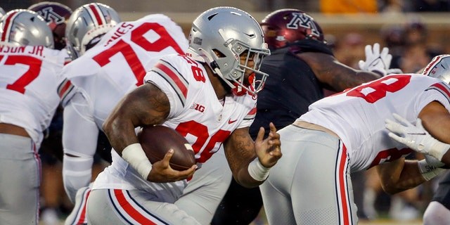 Ohio State running back Miyan Williams (28) rushes for a touchdown against Minnesota in the first quarter of an NCAA college football game on Thursday, September 2, 2021 in Minneapolis.  (AP Photo / Bruce Kluckhohn)