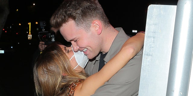 Olivia Jade gets cozy with a mysterious man while she clubs in West Hollywood.