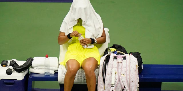 Naomi Osaka, of Japan, covers her head between games against Leylah Fernandez, of Canada, at the third round of the US Open tennis championships, Friday, Sept. 3, 2021, in New York City. (Associated Press)