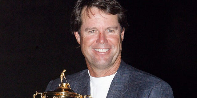 USA Captain Paul Azinger celebrates with the Ryder Cup.