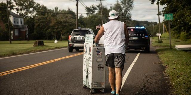 "Retired United Airlines flight attendant , Paul ""Paulie"" Veneto pushing a beverage cart to Ground Zero."