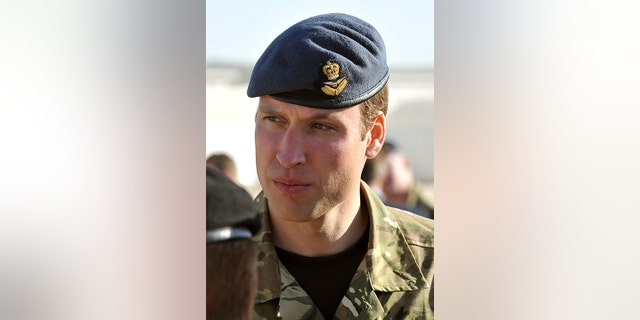 Britain's Prince William speaks with soldiers on November 14, 2010 before a Remembrance Day ceremony at Camp Bastion in southern Afghanistan.  The prince traveled to Afghanistan on November 14 for a surprise visit in honor of the British war dead, as the Queen led the nation in remembrance in London.