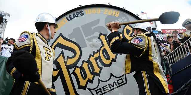 Members of the Purdue Boilermakers hit the Purdue Big Bass Drum before the bowl game against the Auburn Tigers in the 2018 Music City Bowl at Nissan Stadium.