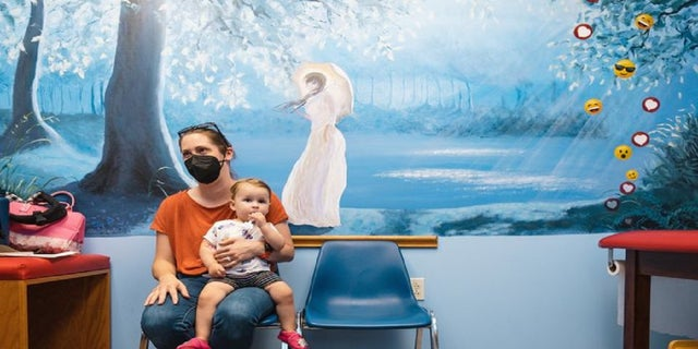 Rachael DiFransico, in the Ohio clinic's waiting room, said she wanted 'our best shot at getting the vaccine as quickly as possible' for Sybil, who is 14 months old.