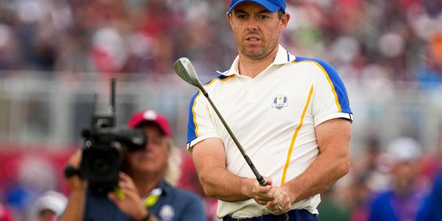 Team Europe's Rory McIlroy watches his shot on the 15th hole during a Ryder Cup singles match at the Whistling Straits Golf Course Sunday, Sept. 26, 2021, in Sheboygan, Wis.