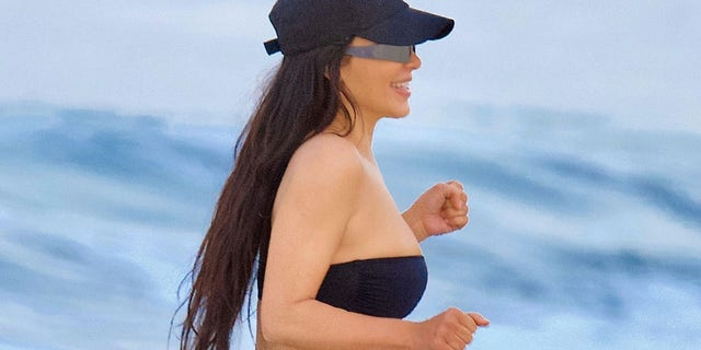 Kardashian's ensemble was completed with metalic-tinted glasses and a baseball cap.