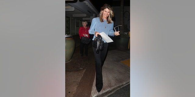 Lori Laughlin makes a rare appearance as she steps out for dinner with friends in Beverly Hills, California, on Thursday night. (Backgrid)