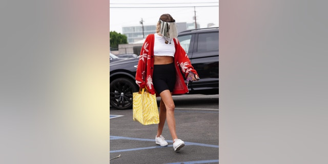 Olivia Jade seen arriving at the 'Dancing with the Stars' practice studio on a cloudy Wednesday afternoon. Her possible partner Val Chmerkovskiy was seen arriving at the same time.