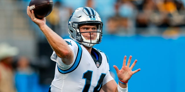 Carolina Panthers quarterback Sam Darnold warm ups before a preseason NFL football game against the Pittsburgh Steelers Aug. 27, 2021, in Charlotte, N.C. Darnold gears up to face his former team, the New York Jets, in the season opener on Sunday. (AP Photo/Nell Redmond, File)
