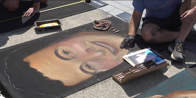 Erick Greenawalt creates a chalk canvas of one of the passengers aboard Flight 93. (FNC/Jayla Whitfield)