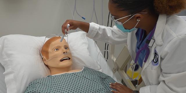 Senior level nursing student Stephania Long practices in the nursing skills lab at Notre Dame of Maryland University. (Jayla Whitfield/Fox News)